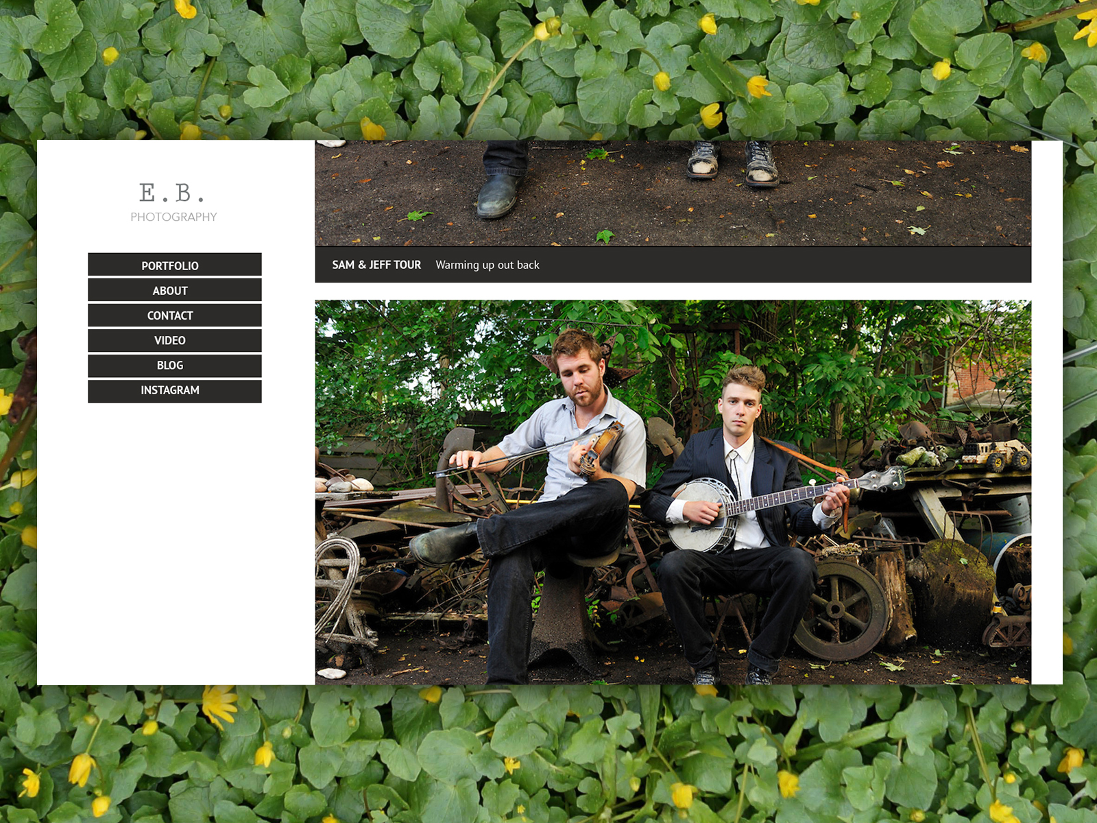 Photography portfolio with a left navigation and a collection of images in the center-right area. The portfolio image shows two musicians, one fiddler and another banjo player, playing outside, surrounded by junk. The entire portfolio is superimposed on a bed of plants.